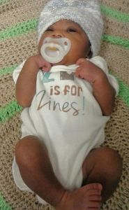WOC Zine founder Tonya Jones welcomes first baby and newest ally to women of color zines! (Onsie by Sally Lee)