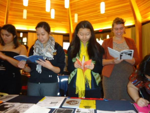 Attendees read zines at Lewis & Clark-Gender Symposium 2014.
