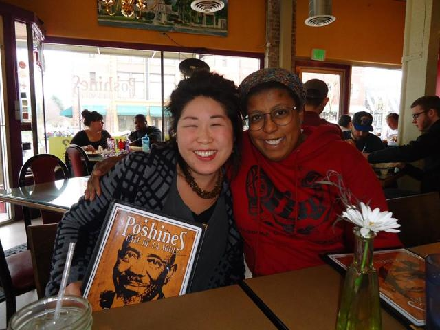 WOC Zine mmeber smiles at Po'shines.