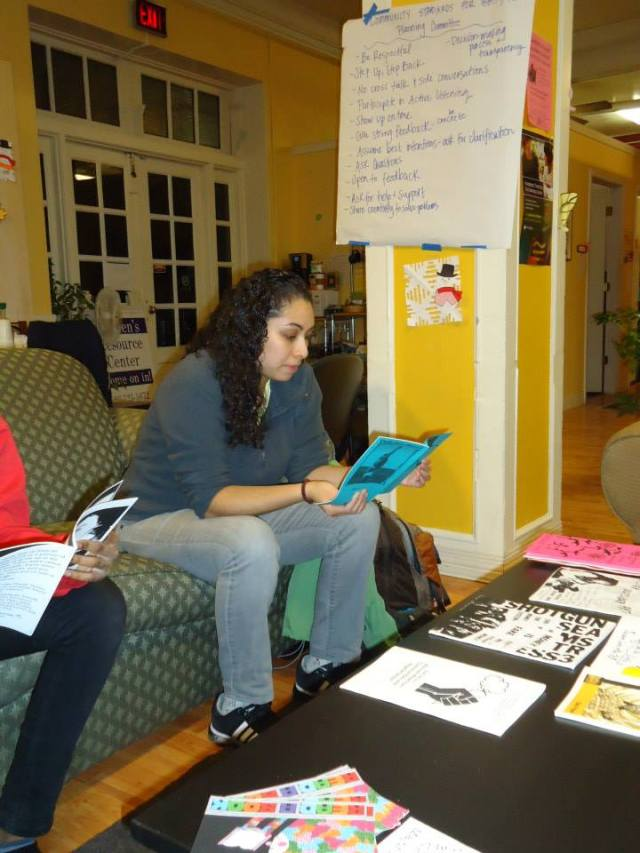 it makes my heart sing, when i see folks reading zines!