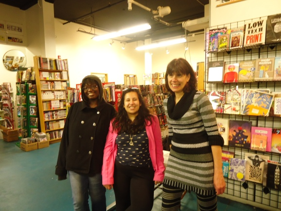 The Women of Color Zine Workshops attend Cathy Camper's Lowriders In Outerspace presentation at Floating World Comics.